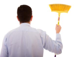 man holding broom